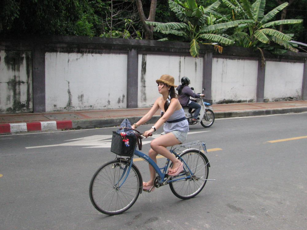 Beautiful Chinese girl tourist riding bicycle in Chiang Ma… | Flickr