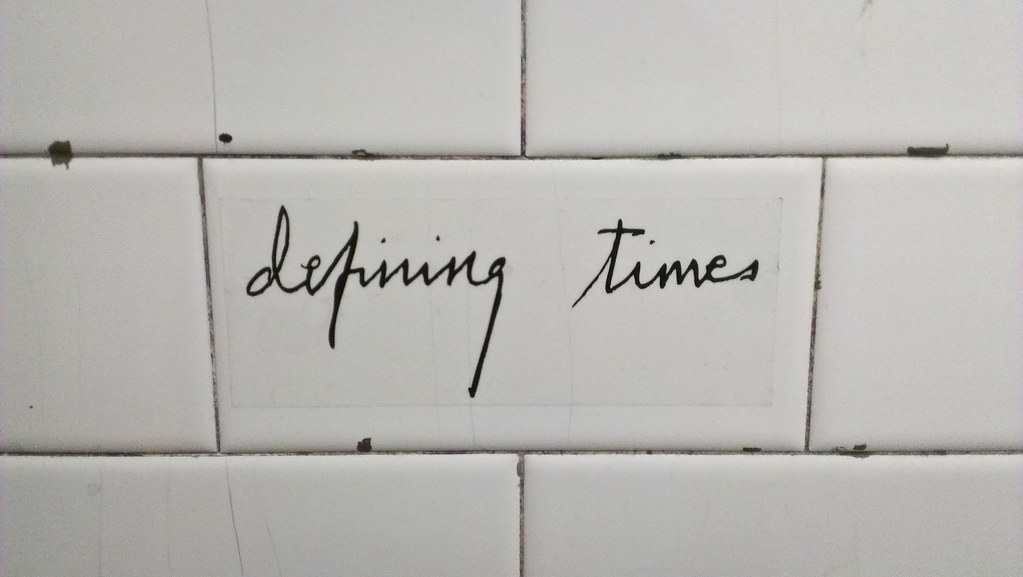 Quot Defining Times Quot Sticker In The Tom Amp Jerry S Bar Bathroom