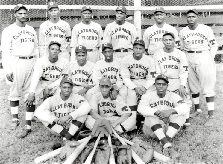 The Claybrook Tigers, 1935. Back Row, left to right: Charlie Henderson, Alfred Saylor, Dan Wilson, Bill Ball, Logan Hensley, and John Lyles. Middle row: Theolic Smith, Walter Calhoun, Roosevelt Tate, Jessie Askew, and unknown. Front row: Handful Davis, Bill Adams, and Emmett Wilson.