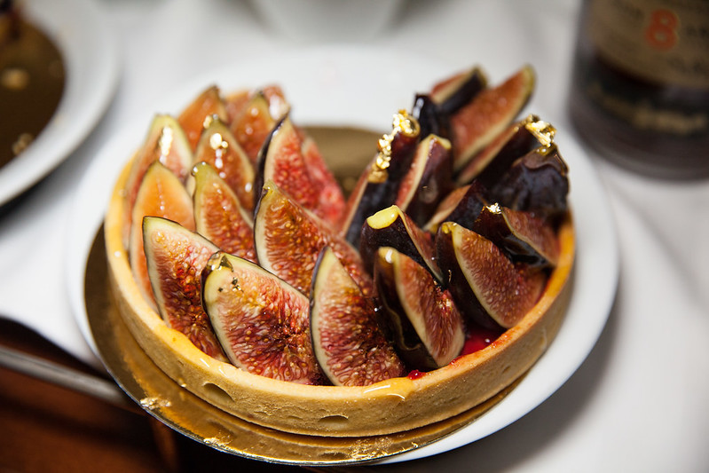 Fig tart with raspberry jam flecked with gold leaf