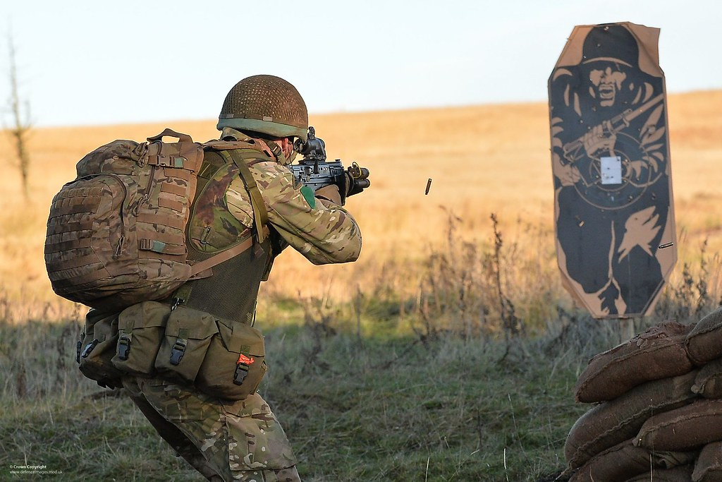 Paratrooper Firing At A Target On Exercise A Paratrooper