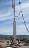 Workers at the Nevada Nuclear Security Site are shown lowering the 25-foot-long Source Physics Experiment (SPE-5) canister into the borehole to its center depth of 76.5 meters or about 250 feet. Photo by Randy Thomas/Rich Rose of LLNL