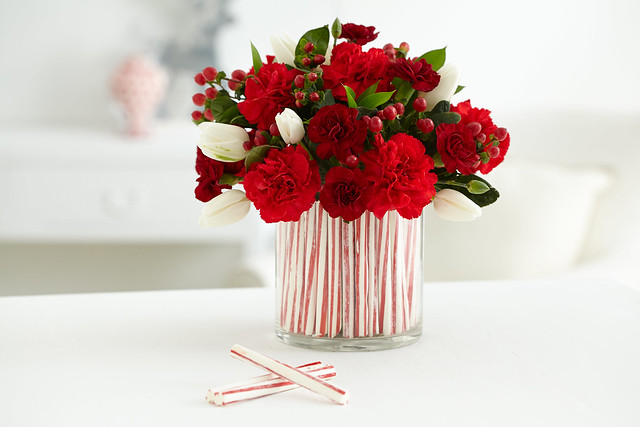 Candy cane centerpiece vase with white tulips and red
