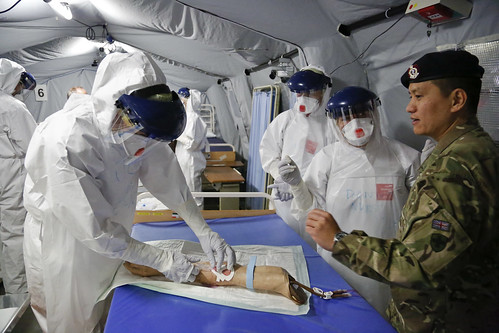 Practising taking blood in Ebola saftey suits