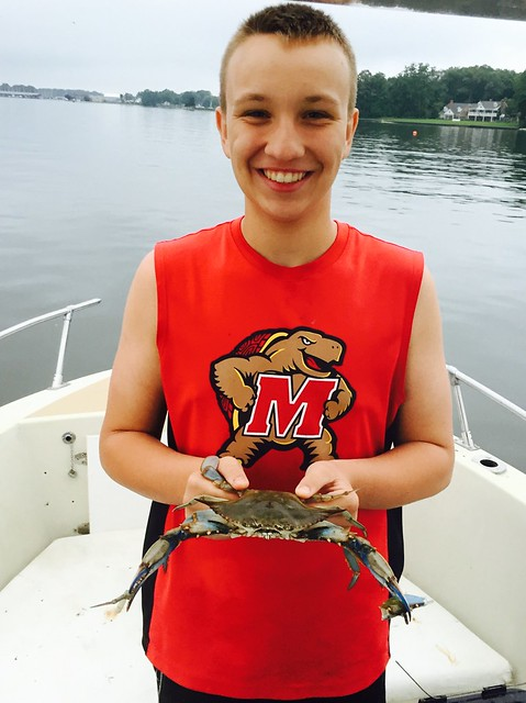 Photo courtesy of Sherry Bishop, Matthew Bishop holding a blue crab