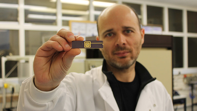 Dr Pedro Estrela in the laboratory with a biosensor device