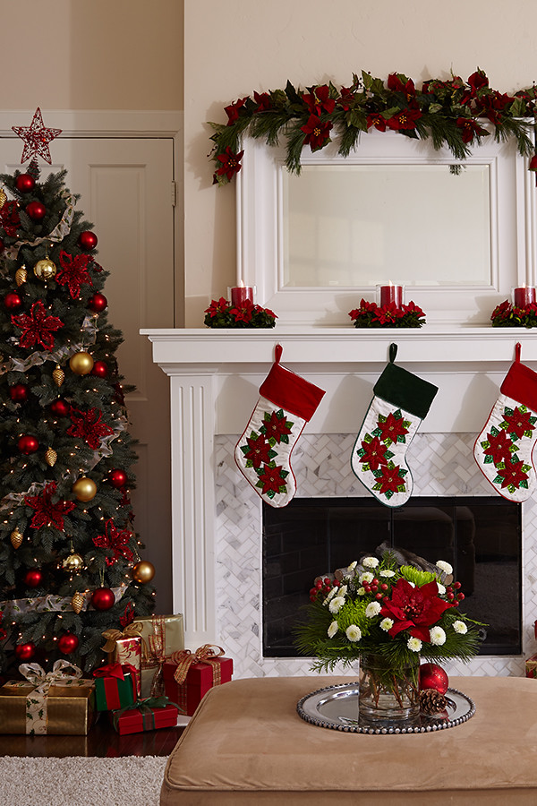Poinsettia Flower Centierpieces With Candles On Mantel Ove