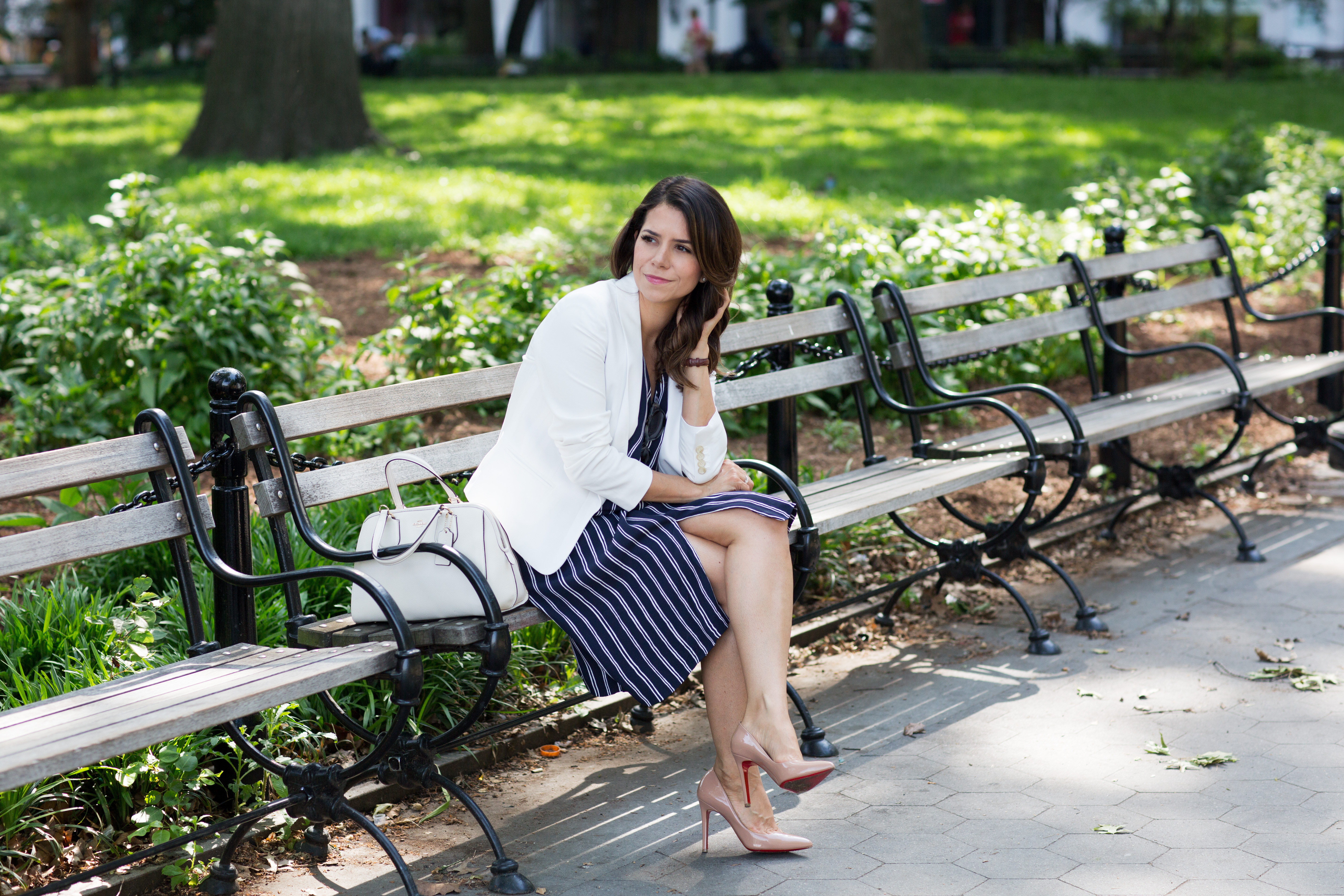 Wearing striped dress with white blazer and white bag in New York during summer on Corporate Catwalk