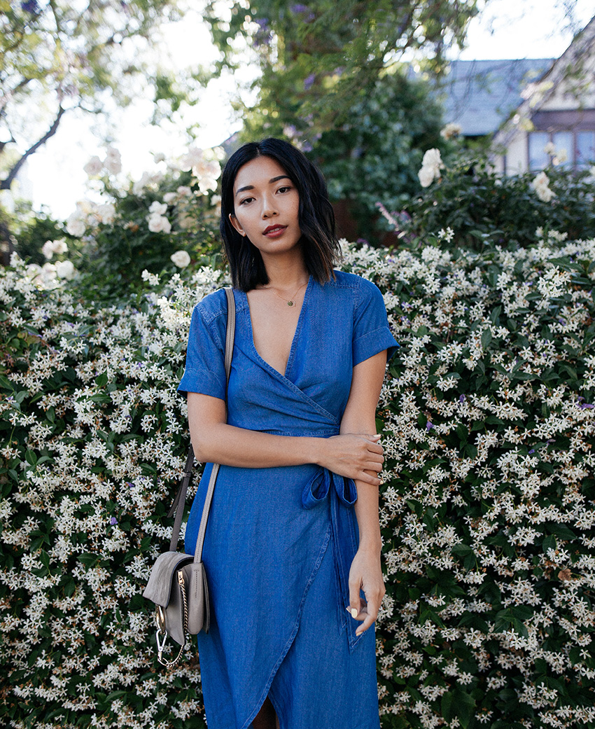 Stephanie Liu of Honey & Silk wearing 7 For All Mankind Denim Wrap Dress, Chloe Faye Bag, and Gucci Heels.