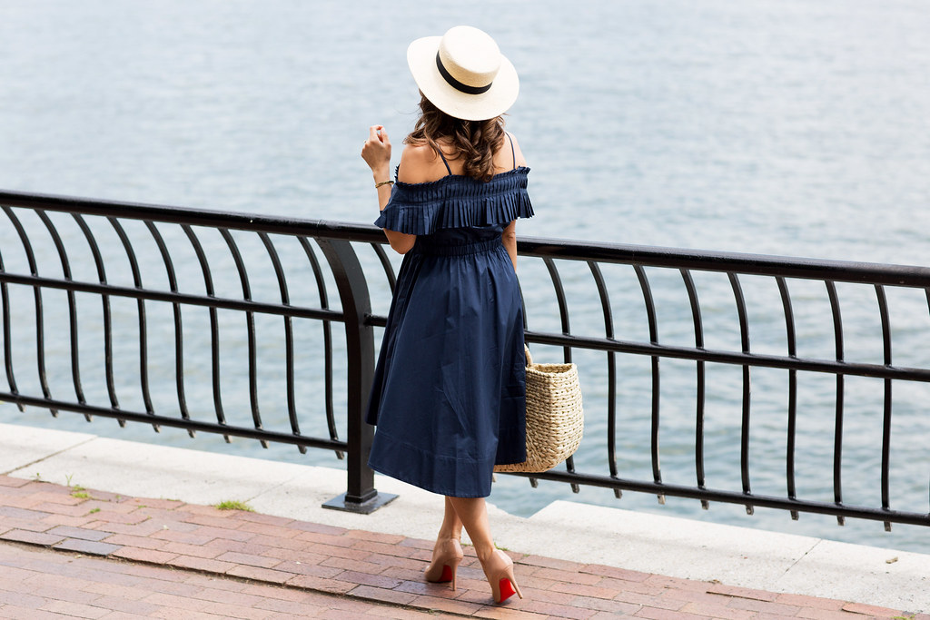 Rent the Runway navy Tibi dress with woven tote Christian Louboutin Pigalle with hat for the summer on Corporate Catwalk