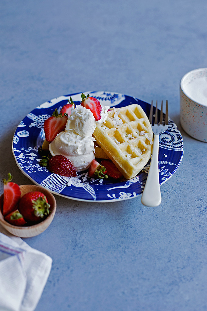 Coconut Oil Waffles | coconut-scented waffles with crisp edges and tender middles, perfect for topping with loads of berries and cream or a generous pour of maple syrup.
