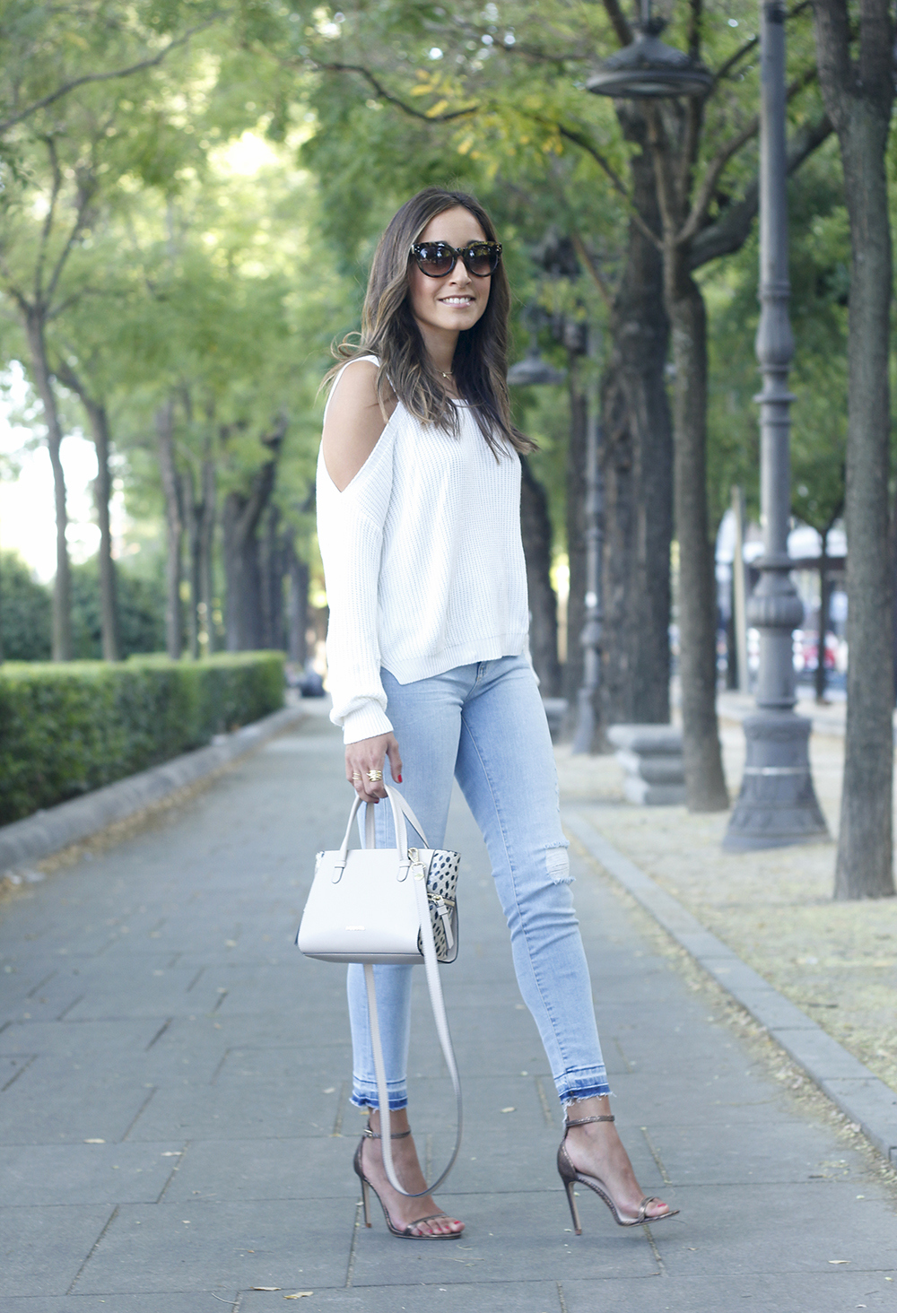 White off the shoulder sweater jeans acosta bag heels outfit style09