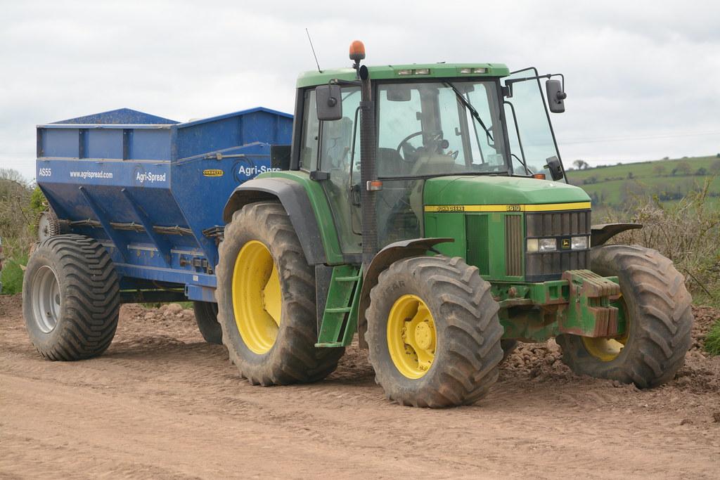 john deere 6610 tractor with an agrispread as55 bulk sprea. Black Bedroom Furniture Sets. Home Design Ideas