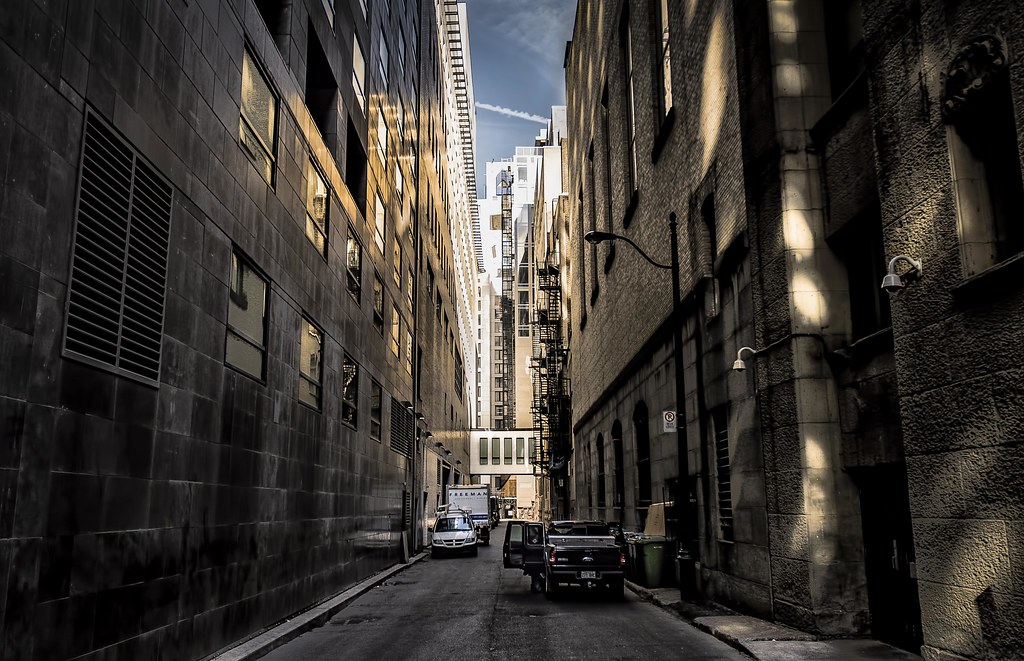 monuments and melodies shot looking down an alley at the