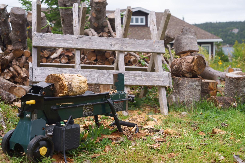 Nick and Nan's cabin cutting wood