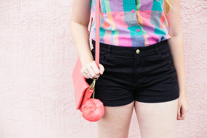 pink purse pompom from francesca's, black high-waisted shorts from H&M