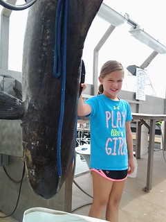Nine-year-old Emma Zadjel with her record-setting cobia