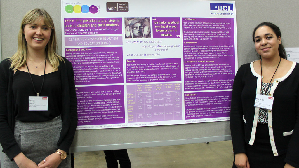 Photo of Katy Warren and Hannah White standing next to their placement poster at the International Meeting for Autism Research