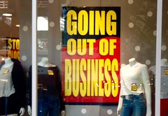 "A 'Going Out of Business' sign."" Title="