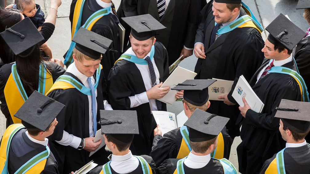 Aerial view of students in graduation robes and mortarboards