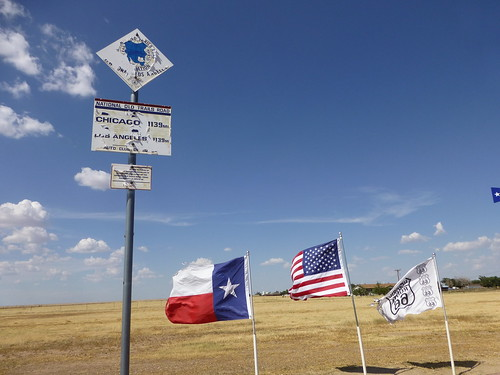 flags at the midpoint of route 66 in texas