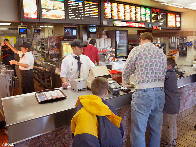 People eating out at a fast food restaurant