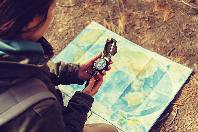 young-woman-using-compass