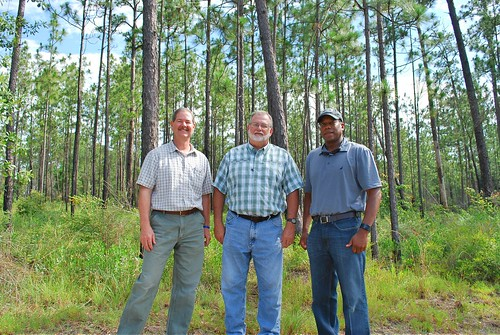 Jimmy Bullock with the Resource Management Service, Andrew Schock with The Conservation Fund and NRCS Alabama State Conservationist Ben Malone