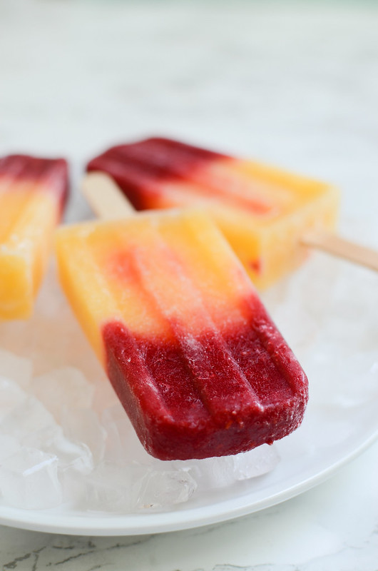 Raspberry-Peach Bellini Popsicles - boozy popsicles for summer! Mix frozen fruit with sparkling wine for this easy and delicious frozen treat!