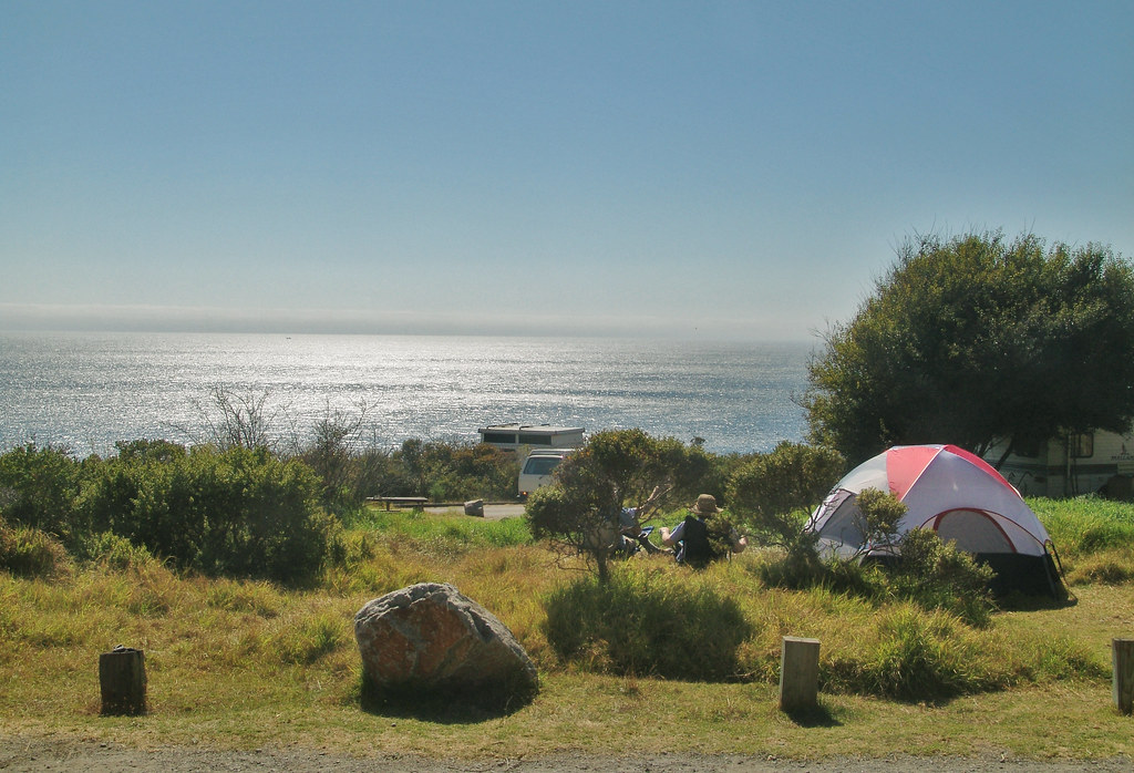 A brightly-colored tent near the ocean in the Kirk Creek Campground provides a base from which to enjoy the view. Route 1 — Big Sur Coast Highway; All-American Road, California