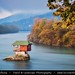 Serbia - Tara National Park - Lonely house perched on a rock in the middle of the Drina River