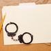 Handcuffs and Folder