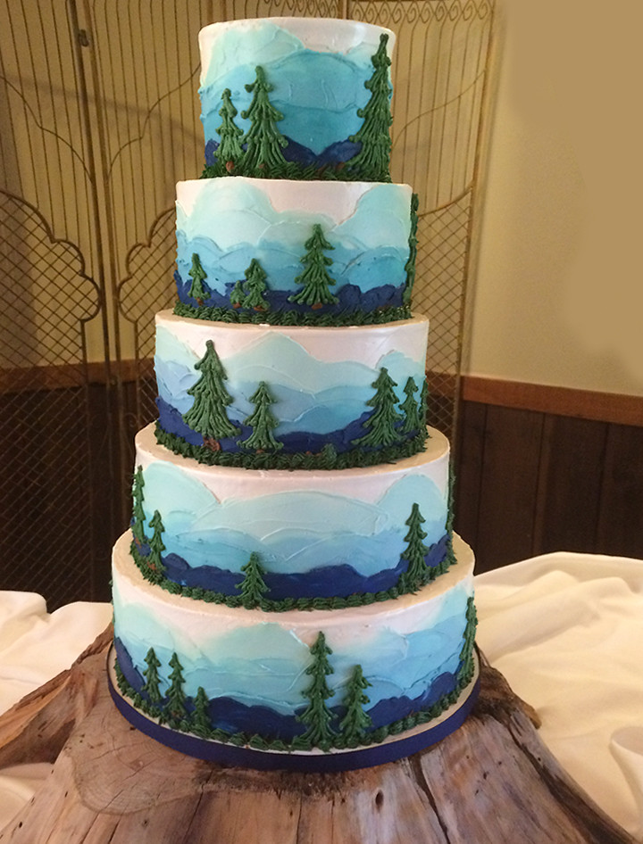 Blue Sky And Mountain Trees On This Wedding Cake A