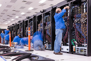picture of the trinity supercomputers with a technician working on the computers
