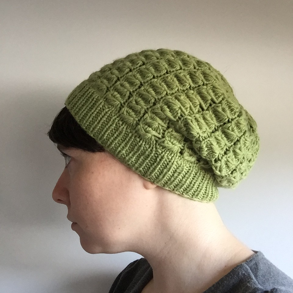 rubus slouchy hat in light green yarn from bendigo woollen mills