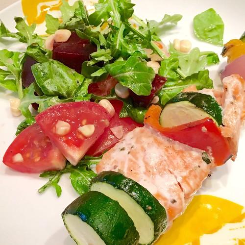 Salmon skewers and salad