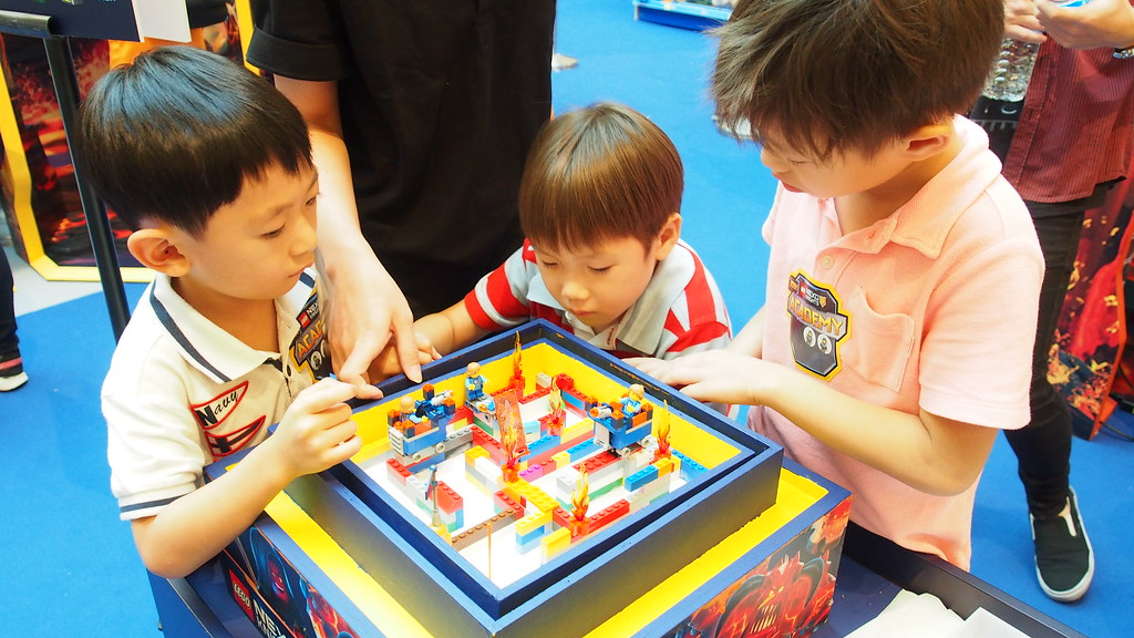Three boys figuring out the maze together.