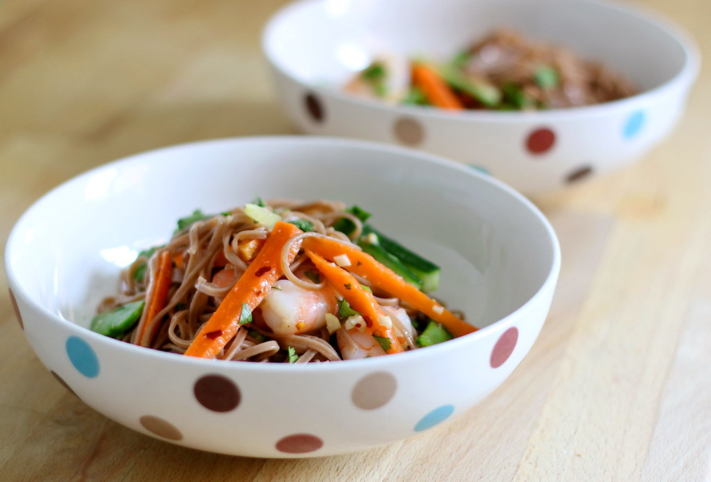 Spring vegetables and noodle salad in bowls