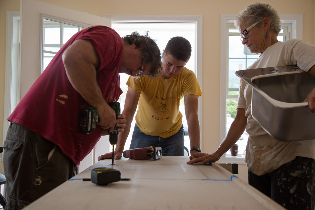 Andrew Lunetta, center, with Sean Redmond and Teresa Doherty install a sink into the counter top of A Tiny Home For Good's first property the week before the ribbon cutting ceremony. | Aubrey Moore