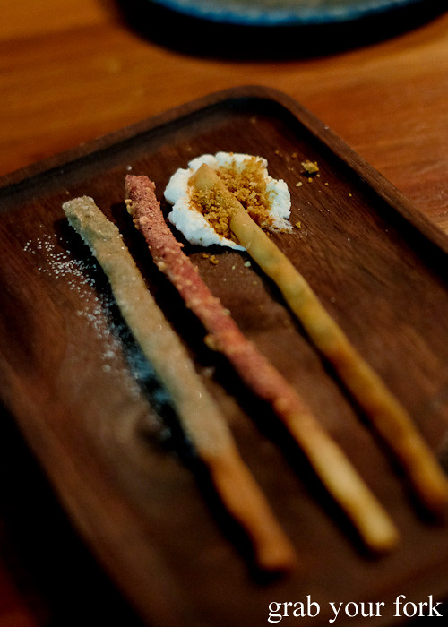 Pocky sticks with quandong; honey and kutjera; and cinnamon myrtle at Restaurant Orana, Adelaide