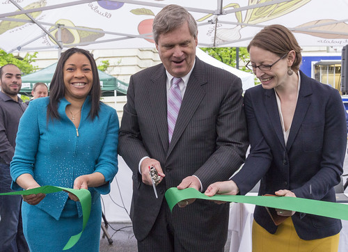 Agriculture Secretary Tom Vilsack (center), GSA Regional Administrator Julia Hudson (left) and AMS Administrator Elanor Starmer (right) officially open the VegUcation tent at the USDA Farmers Market opening. This new feature at the market will help visitors learn how to pick, prepare and store seasonal fruits and vegetables they find at the Farmers Market. USDA photo by Ken Melton.