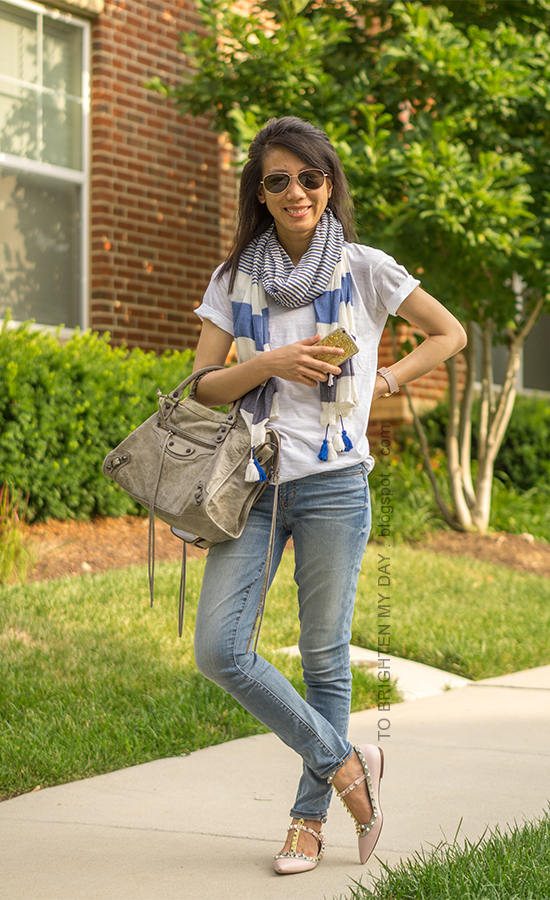 blue striped scarf, white tee, oversized watch, lightwash jeans, gray tote, watercolor studded flats