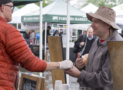 A customer buying a product at the USDA Farmers Market