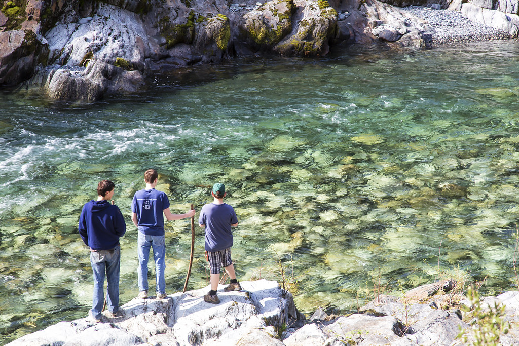 A group of young men on the banks of the North Fork American Wild and Scenic River.