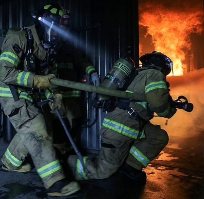 Firefighters in fire training exercise