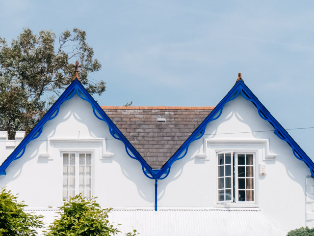 house with blue gable trim