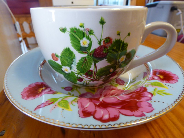 a large size teacup with a plate