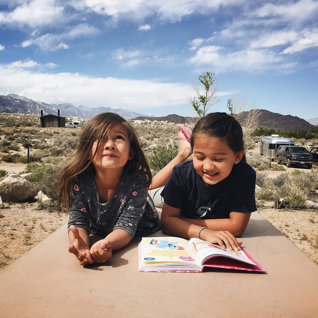 Reading books on top of the campground picnic table in the beautiful Eastern Sierras. This is roadschool. by malimish_marlene