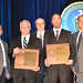 DOE's Office of Small and Disadvantaged Business Utilization presented Mentor and Protégé of the Year awards to LANS and RG Construction Services on May 24, 2016