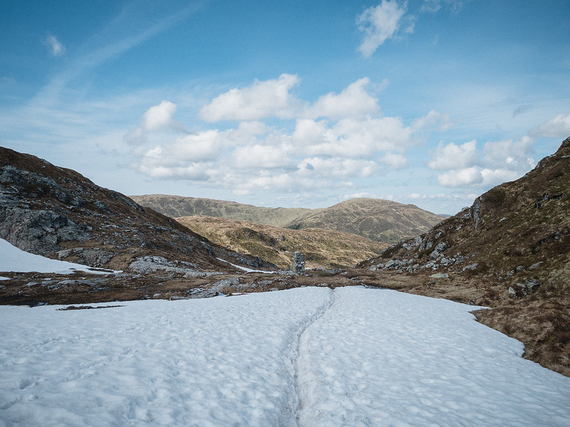 hiking trail through snow in the spring